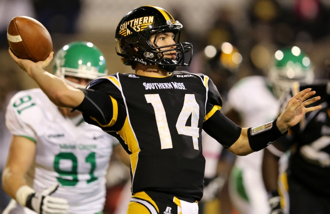 Oct 26, 2013; Hattiesburg, MS, USA; Southern Miss Golden Eagles quarterback Nick Mullens (14) throws the ball in the second half against the North Texas Mean Green at M.M. Roberts Stadium. North Texas won 55-14. Mandatory Credit: Chuck Cook-USA TODAY Sports