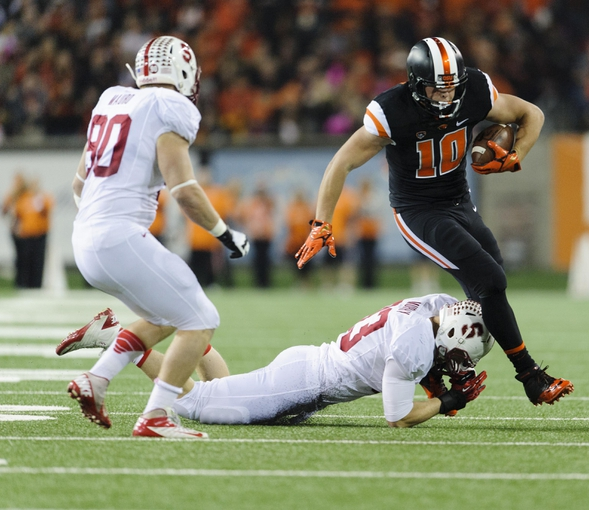 Oct 26, 2013; Corvallis, OR, USA; Oregon State Beavers tight end Caleb Smith (10) breaks a tackle by Stanford Cardinal linebacker Trent Murphy (93) during the 1st half at Reser Stadium. Mandatory Credit: Steven Bisig-USA TODAY Sports