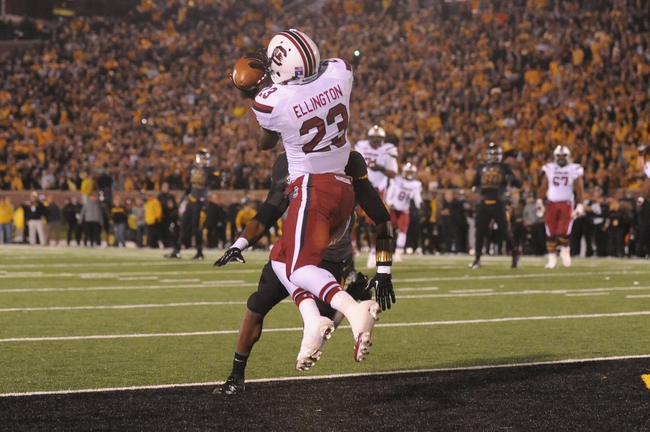 Oct 26, 2013; Columbia, MO, USA; South Carolina Gamecocks wide receiver Bruce Ellington (23) catches to score a touchdown as Missouri Tigers safety Ian Simon (21) defends at Faurot Field. South Carolina won 27-24. Mandatory Credit: Denny Medley-USA TODAY Sports