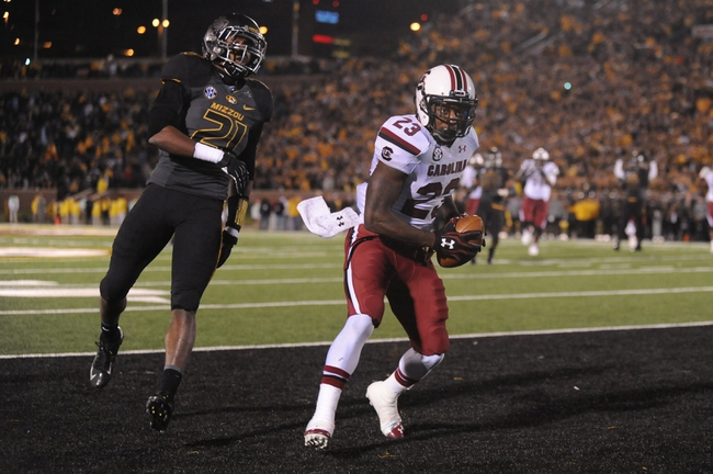 Oct 26, 2013; Columbia, MO, USA; South Carolina Gamecocks wide receiver Bruce Ellington (23) catches a pass for a touchdown as Missouri Tigers safety Ian Simon (21) defends during the first at Faurot Field. South Carolina won 27-24. Mandatory Credit: Denny Medley-USA TODAY Sports