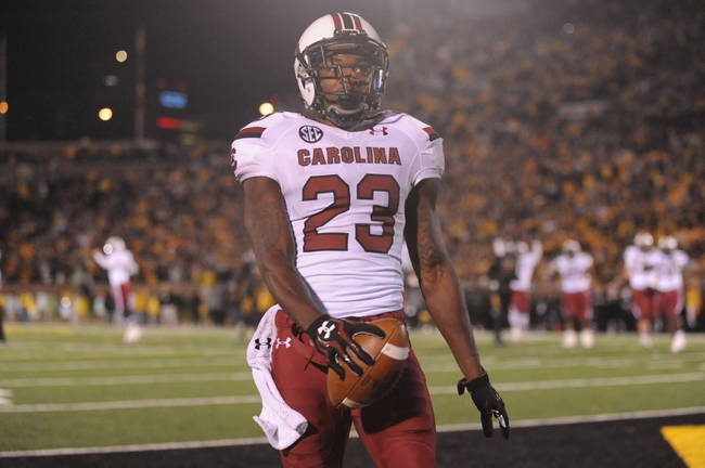 Oct 26, 2013; Columbia, MO, USA; South Carolina Gamecocks wide receiver Bruce Ellington (23) celebrates after scoring a touchdown against the Missouri Tigers at Faurot Field. South Carolina won 27-24. Mandatory Credit: Denny Medley-USA TODAY Sports