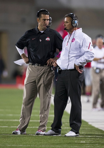 Oct 26, 2013; Columbus, OH, USA; Ohio State Buckeyes head coach Urban Meyer consults with assistant coach Luke Fickell in the game against the Penn State Nittany Lions at Ohio Stadium. Mandatory Credit: Greg Bartram-USA TODAY Sports