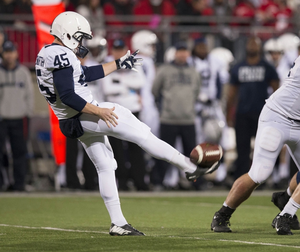 Oct 26, 2013; Columbus, OH, USA; Penn State Nittany Lions punter Alex Butterworth (45) sends the ball downfield against the Ohio State Buckeyes at Ohio Stadium. Mandatory Credit: Greg Bartram-USA TODAY Sports