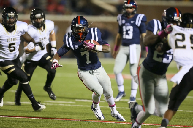 Oct 26, 2013; Oxford, MS, USA;  Mississippi Rebels running back Mark Dodson (7) advances the ball during the game against the Idaho Vandals at Vaught-Hemingway Stadium. Mississippi Rebels win the game against the Idaho Vandals with a score of 59-14.  Mandatory Credit: Spruce Derden-USA TODAY Sports