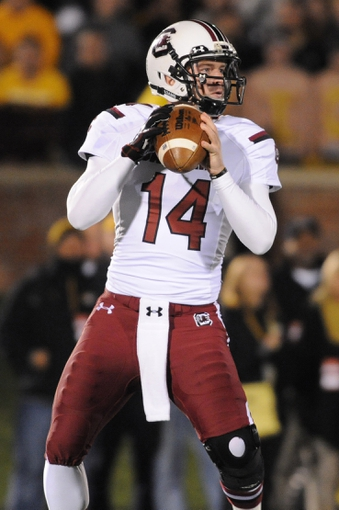 Oct 26, 2013; Columbia, MO, USA; South Carolina Gamecocks quarterback Connor Shaw (14) throws the ball during the second half against the Missouri Tigers at Faurot Field. South Carolina won 27-24. Mandatory Credit: Denny Medley-USA TODAY Sports