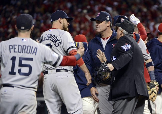 Oct 26, 2013; St. Louis, MO, USA; Boston Red Sox third baseman Will Middlebrooks (second from left), second baseman Dustin Pedroia (15) and manager John Farrell (second from right) argue with home plate umpire Dana Demuth (right) after a base runner's interference call was made in the 9th inning during game three of the MLB baseball World Series against the St. Louis Cardinals at Busch Stadium. Mandatory Credit: Eileen Blass-USA TODAY Sports