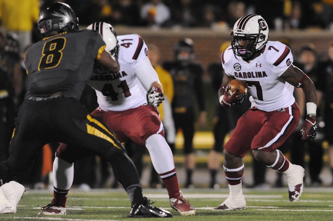 Oct 26, 2013; Columbia, MO, USA; South Carolina Gamecocks running back Shon Carson (7) runs with the ball during the second half of the game against the Missouri Tigers at Faurot Field. South Carolina won 27-24. Mandatory Credit: Denny Medley-USA TODAY Sports