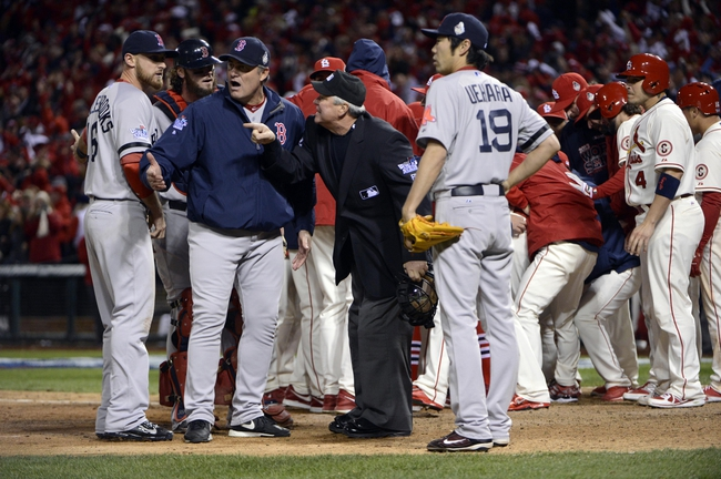 Oct 26, 2013; St. Louis, MO, USA; St. Louis Cardinals players celebrate the winning run as Boston Red Sox third baseman Will Middlebrooks (16) , manager John Farrell (second from left) and relief pitcher Koji Uehara (19) argue with home plate umpire Dana Demuth after an obstruction was called in the 9th inning during game three of the MLB baseball World Series at Busch Stadium. Mandatory Credit: Eileen Blass-USA TODAY Sports