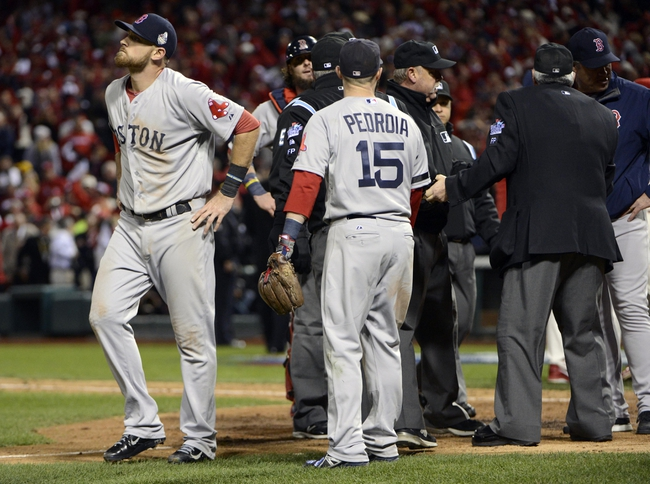 Oct 26, 2013; St. Louis, MO, USA; Boston Red Sox third baseman Will Middlebrooks (left) and second baseman Dustin Pedroia (15) react after an obstruction was called allowing the St. Louis Cardinals winning run to score in the 9th inning of game three of the MLB baseball World Series at Busch Stadium. Mandatory Credit: Eileen Blass-USA TODAY Sports