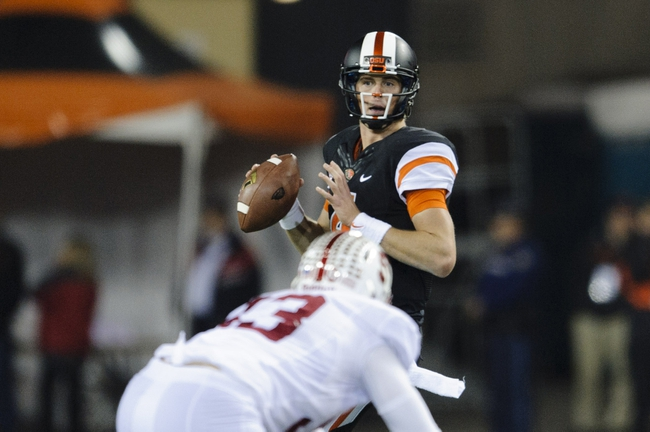 Oct 26, 2013; Corvallis, OR, USA; Oregon State Beavers quarterback Sean Mannion (4) looks to pass the ball during the first half against the Stanford Cardinal at Reser Stadium. Mandatory Credit: Steven Bisig-USA TODAY Sports