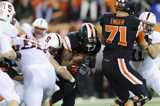 Oct 26, 2013; Corvallis, OR, USA; Oregon State Beavers running back Storm Woods (24) runs with the ball against the Stanford Cardinal at Reser Stadium. Mandatory Credit: Steven Bisig-USA TODAY Sports