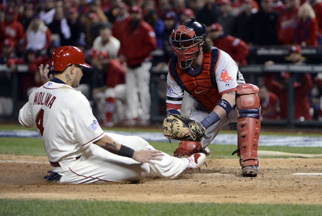 Oct 26, 2013; St. Louis, MO, USA; St. Louis Cardinals catcher Yadier Molina (4) is tagged out by Boston Red Sox catcher Jarrod Saltalamacchia (right) in the 9th inning during game three of the MLB baseball World Series at Busch Stadium. Mandatory Credit: Eileen Blass-USA TODAY Sports
