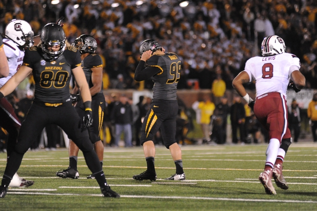 Oct 26, 2013; Columbia, MO, USA; Missouri Tigers kicker Adrew Baggett (99) reacts missing a field goal during the second overtime of the game against the South Carolina Gamecocks at Faurot Field. South Carolina won 27-24. Mandatory Credit: Denny Medley-USA TODAY Sports