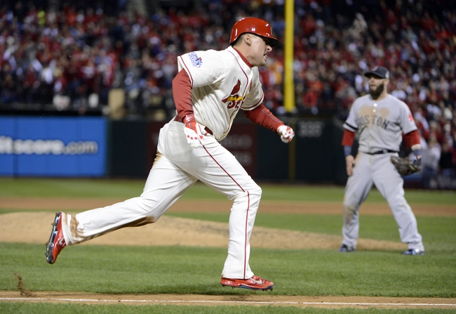 Oct 26, 2013; St. Louis, MO, USA; St. Louis Cardinals pinch hitter Allen Craig (21) heads for home in the 9th inning against the Boston Red Sox during game three of the MLB baseball World Series at Busch Stadium. Mandatory Credit: Eileen Blass-USA TODAY Sports