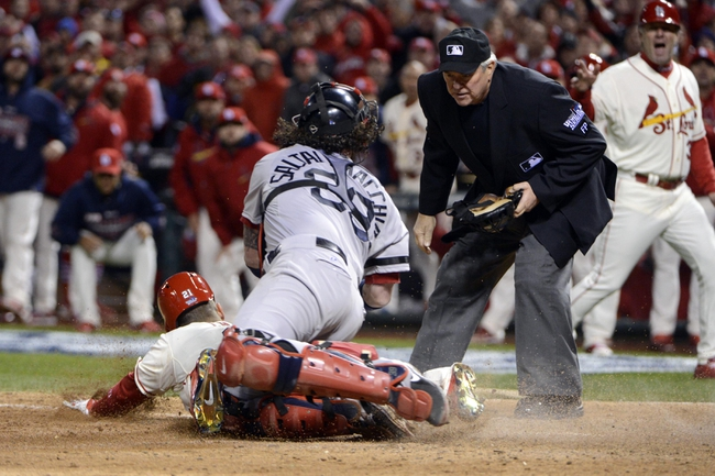 Oct 26, 2013; St. Louis, MO, USA; Boston Red Sox catcher Jarrod Saltalamacchia (39) tags St. Louis Cardinals pinch hitter Allen Craig (left) as umpire Dana Demuth looks on in the 9th inning during game three of the MLB baseball World Series at Busch Stadium. Craig was called safe on an obstruction call. Mandatory Credit: Eileen Blass-USA TODAY Sports