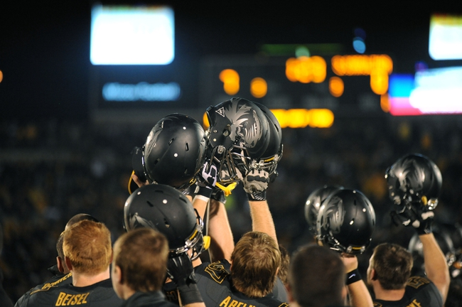 Oct 26, 2013; Columbia, MO, USA; Missouri Tigers players lift up their helmets before a kickoff during the second half of the game against the South Carolina Gamecocks at Faurot Field. South Carolina won 27-24. Mandatory Credit: Denny Medley-USA TODAY Sports