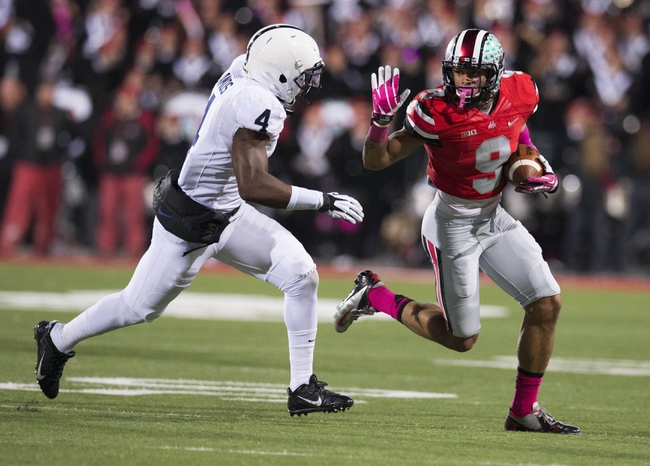 Oct 26, 2013; Columbus, OH, USA; Ohio State Buckeyes wide receiver Devin Smith (9) runs the ball against Penn State Nittany Lions safety Adrian Amos (4) at Ohio Stadium. Ohio State won the game 63-14. Mandatory Credit: Greg Bartram-USA TODAY Sports