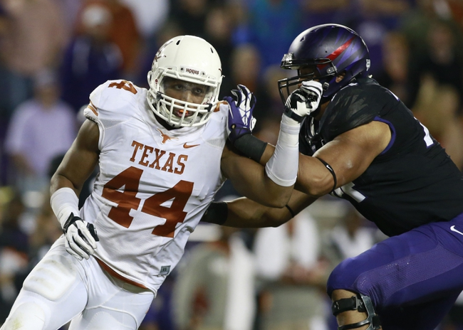 Oct 26, 2013; Fort Worth, TX, USA; Texas Longhorns defensive end Jackson Jeffcoat (44) rushes the passer against TCU Horned Frogs offensive tackle Halapoulivaati Vaitai (74) in the third quarter of the game at Amon G. Carter Stadium. Mandatory Credit: Tim Heitman-USA TODAY Sports