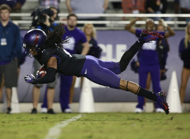 Oct 26, 2013; Fort Worth, TX, USA; TCU Horned Frogs cornerback Jason Verrett (2) intercepts a pass in the third quarter of the game against the Texas Longhorns at Amon G. Carter Stadium. Mandatory Credit: Tim Heitman-USA TODAY Sports