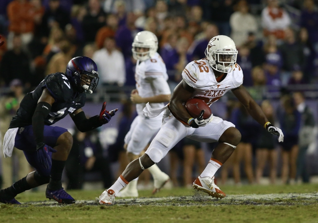 Oct 26, 2013; Fort Worth, TX, USA; Texas Longhorns running back Johnathan Gray (32) runs the ball against TCU Horned Frogs linebacker Paul Dawson (47) in the third quarter of the game at Amon G. Carter Stadium. Mandatory Credit: Tim Heitman-USA TODAY Sports