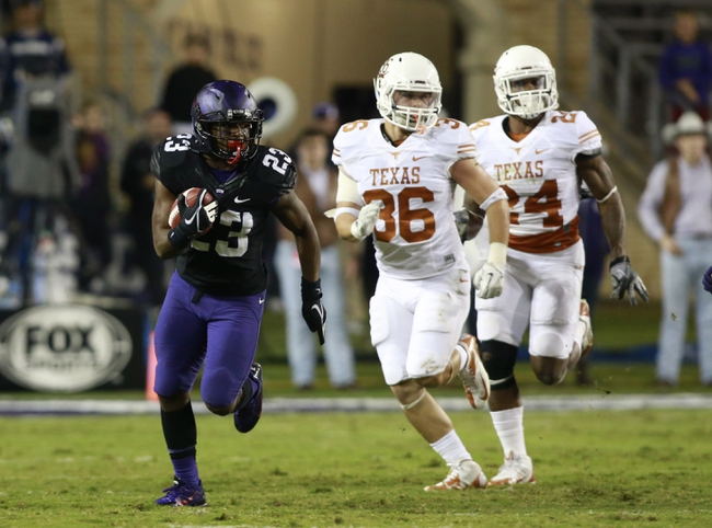 Oct 26, 2013; Fort Worth, TX, USA; TCU Horned Frogs running back B.J. Catalon (23) returns a punt against the Texas Longhorns in the third quarter of the game at Amon G. Carter Stadium. Mandatory Credit: Tim Heitman-USA TODAY Sports