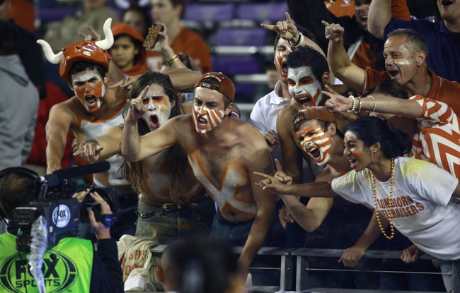 Oct 26, 2013; Fort Worth, TX, USA; Texas Longhorns fans cheer into the television camera during the game against the TCU Horned Frogs at Amon G. Carter Stadium. The Texas Longhorns beat the TCU Horned Frogs 30-7. Mandatory Credit: Tim Heitman-USA TODAY Sports