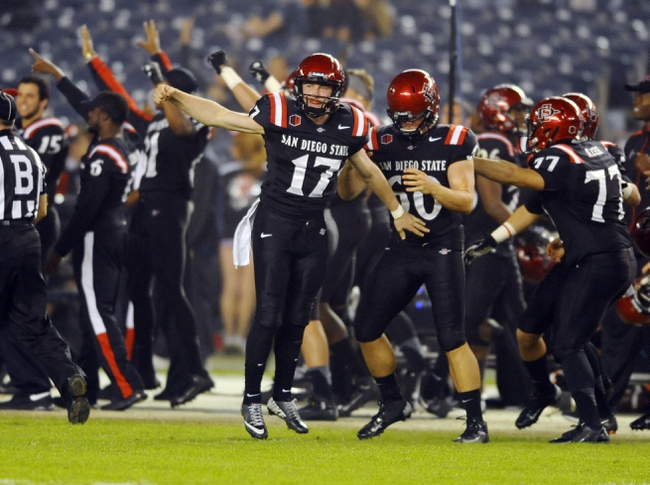 Oct 26, 2013; San Diego, CA, USA; San Diego State Aztecs players celebrate on the sidelines after recovering an onside kick during the second half against the Fresno State Bulldogs at Qualcomm Stadium. Mandatory Credit: Christopher Hanewinckel-USA TODAY Sports