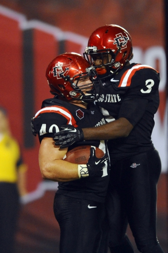 Oct 26, 2013; San Diego, CA, USA; San Diego State fullback Chad Young (40) celebrates with wide receiver Ezell Ruffin (3) after a touchdown to tie the game during the second half against the Fresno State Bulldogs at Qualcomm Stadium. Mandatory Credit: Christopher Hanewinckel-USA TODAY Sports
