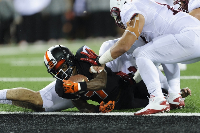 Oct 26, 2013; Corvallis, OR, USA; Oregon State Beavers wide receiver Brandin Cooks (7) scores a touchdown against the Stanford Cardinal during the 2nd half at Reser Stadium. Stanford defeated Oregon State 20-12. Mandatory Credit: Steven Bisig-USA TODAY Sports
