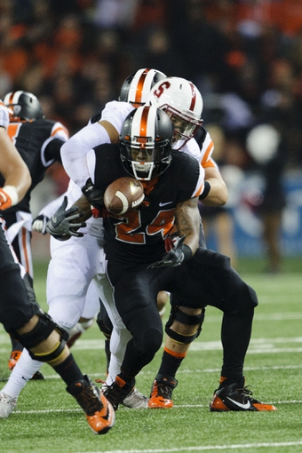 Oct 26, 2013; Corvallis, OR, USA; Oregon State Beavers running back Storm Woods (24) fumbles the ball during the 2nd half against the Stanford Cardinal at Reser Stadium. Stanford defeated Oregon State 20-12. Mandatory Credit: Steven Bisig-USA TODAY Sports