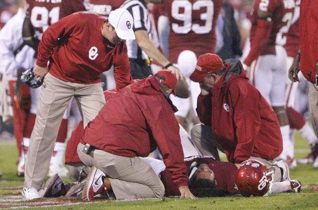 Oct 26, 2013; Norman, OK, USA; Oklahoma Sooners player Trey Millard is injured after a play against the Texas Tech Red Raiders during the fourth quarter at Gaylord Family - Oklahoma Memorial Stadium. Oklahoma won 38-30.  Mandatory Credit: Alonzo Adams-USA TODAY Sports