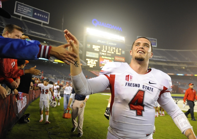 Oct 26, 2013; San Diego, CA, USA; Fresno State Bulldogs quarterback Derek Carr (4) celebrates following a 35-28 win in overtime against the San Diego State Aztecs at Qualcomm Stadium. Mandatory Credit: Christopher Hanewinckel-USA TODAY Sports