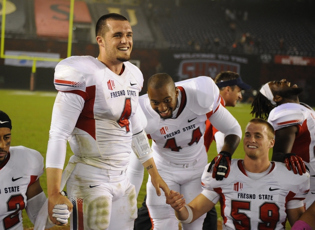 Oct 26, 2013; San Diego, CA, USA; Fresno State Bulldogs quarterback Derek Carr (4) with teammates before leading them in a prayer following a 35-28 overtime win against the San Diego State Aztecs at Qualcomm Stadium. Mandatory Credit: Christopher Hanewinckel-USA TODAY Sports