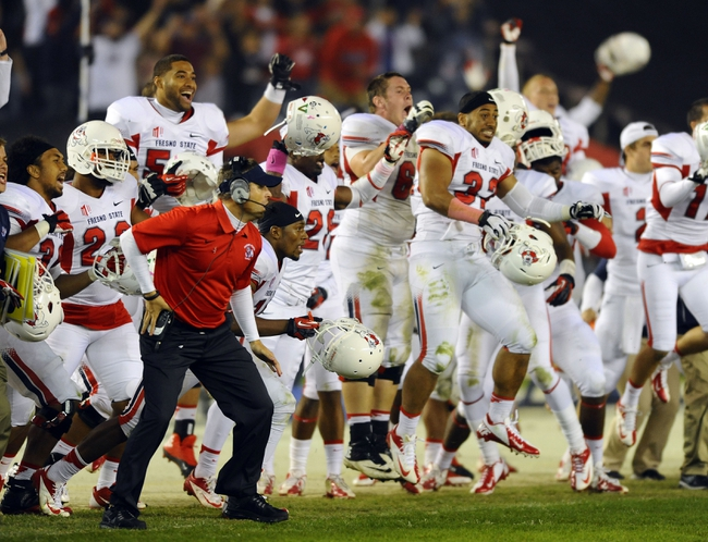 Oct 26, 2013; San Diego, CA, USA; Fresno State Bulldogs players celebrate following a fourth down stop in overtime against the San Diego State Aztecs at Qualcomm Stadium. Fresno State won 35-28 in overtime. Mandatory Credit: Christopher Hanewinckel-USA TODAY Sports