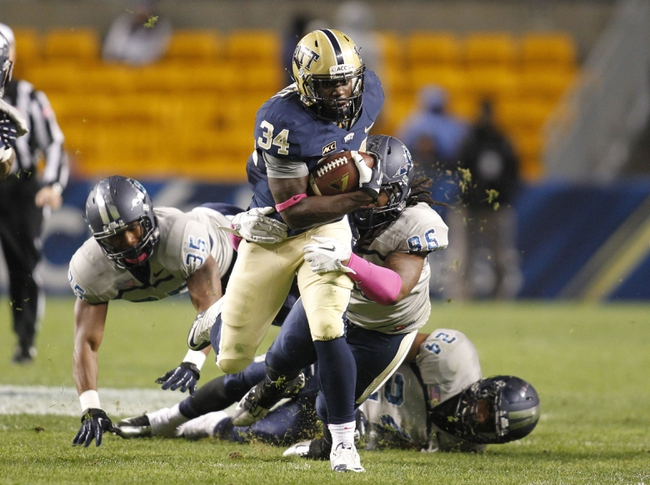 Oct 19, 2013; Pittsburgh, PA, USA; Pittsburgh Panthers running back Isaac Bennett (34) rushes the ball against Old Dominion Monarchs linebacker Anthony Wilson (35) and defensive tackle Nate Barnes (95) and safety Fellonte Misher (24) during the third quarter at Heinz Field.  Pittsburgh won 35-24. Mandatory Credit: Charles LeClaire-USA TODAY Sports