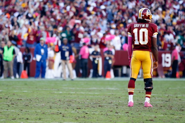 Oct 20, 2013; Landover, MD, USA; Washington Redskins quarterback Robert Griffin III (10) stands on the field against the Chicago Bears at FedEx Field. Mandatory Credit: Geoff Burke-USA TODAY Sports