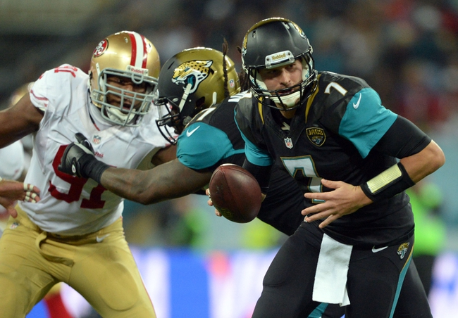 Oct 27, 2013; London, UNITED KINGDOM; Jacksonville Jaguars quarterback Chad Henne (7) runs away from San Francisco 49ers defensive end Ray McDonald (91) during an International Series game at Wembley Stadium. Mandatory Credit: Bob Martin-USA TODAY Sports