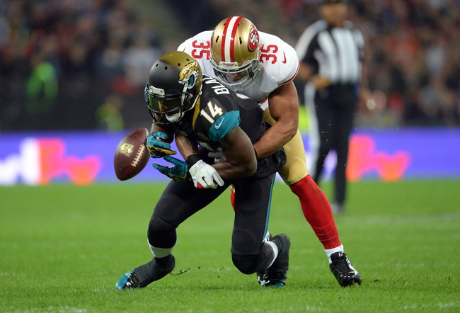 Oct 27, 2013; London, UNITED KINGDOM; San Francisco 49ers free safety Eric Reid (35) breaks up a pass intended for Jacksonville Jaguars wide receiver Justin Blackmon (14) during an International Series game at Wembley Stadium. Mandatory Credit: Bob Martin-USA TODAY Sports