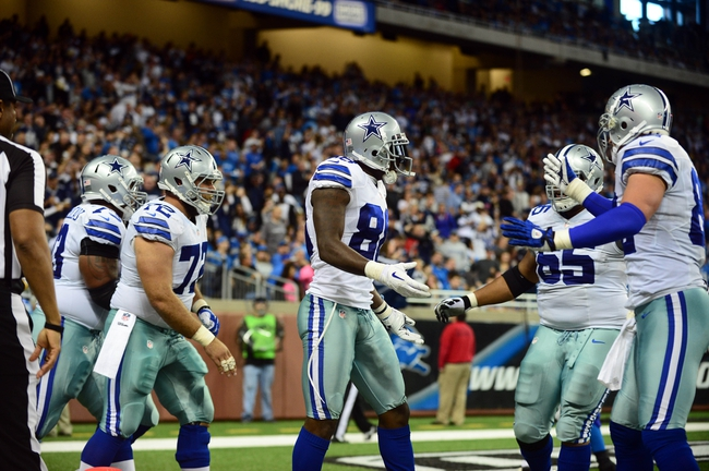 Oct 27, 2013; Detroit, MI, USA; Dallas Cowboys wide receiver Dez Bryant (88) celebrates with teammates after scoring a touchdown during the fourth quarter against the Detroit Lions at Ford Field. Mandatory Credit: Andrew Weber-USA TODAY Sports