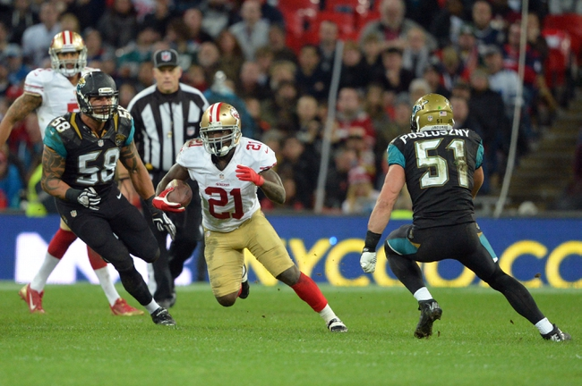 Oct 27, 2013; London, UNITED KINGDOM; San Francisco 49ers running back Frank Gore (21) runs between 	pjax59n and middle linebacker Paul Posluszny (51) during an International Series game at Wembley Stadium. Mandatory Credit: Bob Martin-USA TODAY Sports