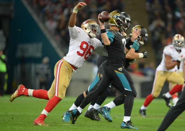 Oct 27, 2013; London, UNITED KINGDOM; Jacksonville Jaguars quarterback Chad Henne (7) is pressured by San Francisco 49ers linebacker Corey Lemonier (96)  during an International Series game at Wembley Stadium. Mandatory Credit: Bob Martin-USA TODAY Sports