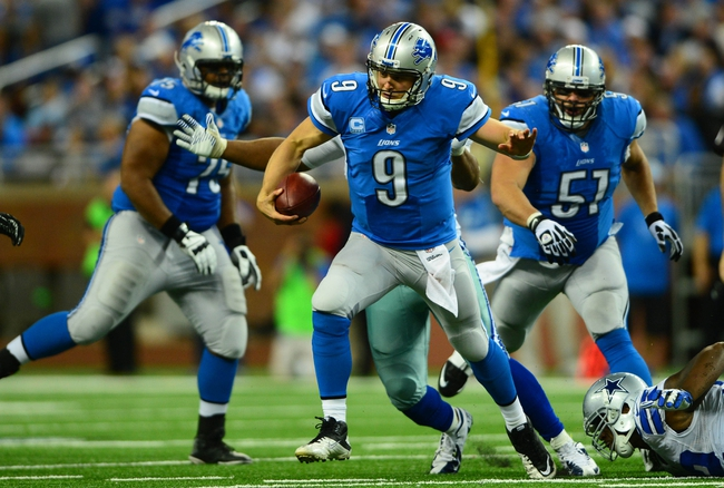 Oct 27, 2013; Detroit, MI, USA; Detroit Lions quarterback Matthew Stafford (9) runs out of the pocket during the third quarter against the Dallas Cowboys at Ford Field. Mandatory Credit: Andrew Weber-USA TODAY Sports