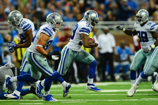 Oct 27, 2013; Detroit, MI, USA; Dallas Cowboys cornerback Brandon Carr (39) runs the ball during the third quarter against the Detroit Lions at Ford Field. Mandatory Credit: Andrew Weber-USA TODAY Sports