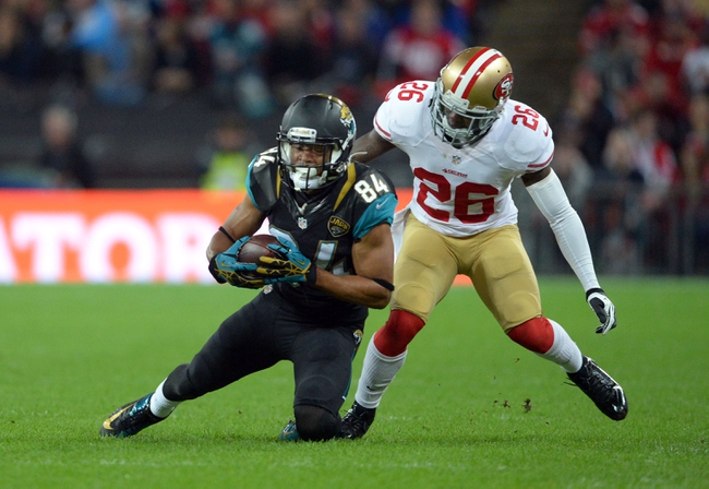 Oct 27, 2013; London, UNITED KINGDOM; Jacksonville Jaguars wide receiver Cecil Shorts (84) catches a pass in front of San Francisco 49ers defensive back Tramaine Brock (26)  during an International Series game at Wembley Stadium. Mandatory Credit: Bob Martin-USA TODAY Sports