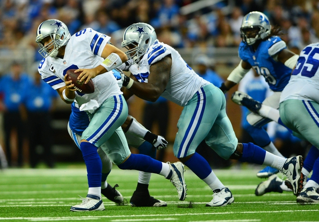 Oct 27, 2013; Detroit, MI, USA; Dallas Cowboys quarterback Tony Romo (9) escapes from being sacked during the third quarter against the Detroit Lions at Ford Field. Mandatory Credit: Andrew Weber-USA TODAY Sports