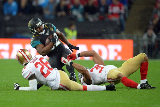 Oct 27, 2013; London, UNITED KINGDOM; Jacksonville Jaguars running back Maurice Jones-Drew (32) runs with the ball against the San Francisco 49ers during an International Series game at Wembley Stadium. Mandatory Credit: Bob Martin-USA TODAY Sports