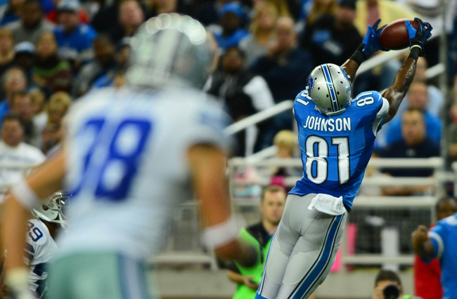 Oct 27, 2013; Detroit, MI, USA; Detroit Lions wide receiver Calvin Johnson (81) makes a catch during the third quarter against the Dallas Cowboys at Ford Field. Mandatory Credit: Andrew Weber-USA TODAY Sports