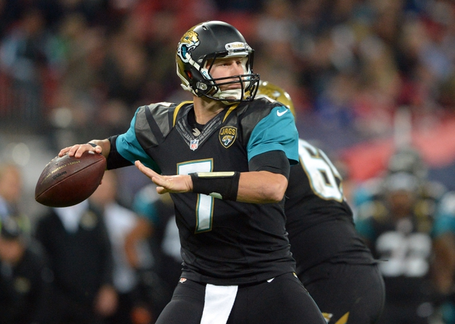 Oct 27, 2013; London, UNITED KINGDOM; Jacksonville Jaguars quarterback Chad Henne throws a pass against the San Francisco 49ers during an International Series game at Wembley Stadium. Mandatory Credit: Bob Martin-USA TODAY Sports