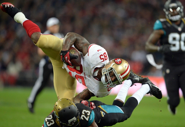 Oct 27, 2013; London, UNITED KINGDOM; San Francisco 49ers tight end Vernon Davis (85) is tackled by Jacksonville Jaguars cornerback Alan Ball (23)  during an International Series game at Wembley Stadium. Mandatory Credit: Bob Martin-USA TODAY Sports