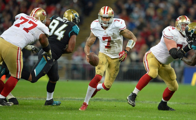 Oct 27, 2013; London, UNITED KINGDOM; San Francisco 49ers quarterback Colin Kaepernick (7) scrambles with the ball against the Jacksonville Jaguars during an International Series game at Wembley Stadium. Mandatory Credit: Bob Martin-USA TODAY Sports